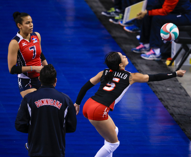 Dominican Republic's Brenda Castillo (5) attempts to save the ball with teammate Niverka Dharlenis Marte Frica (7) watching, in a women's volleyball NORCECA round-robin Olympic qualifying tournament match against Puerto Rico in Lincoln, Neb., Thursday, Jan. 7, 2016. (AP Photo/Nati Harnik)